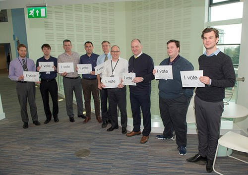 Male staff at HDC celebrate their right to vote