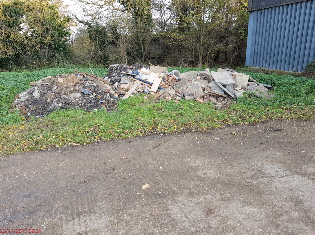 Fly tipping garbage in park
